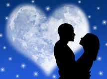 Lovers night. Lovers in a starry night with a heart shape moon Royalty Free Stock Photo
