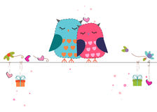 Lovers owls hanging gift box and hearts vector background Stock Images