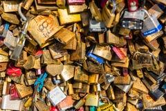 Lovers padlocks on a bridge in Paris Stock Images
