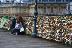 Lovers and padlocks on pont des arts, Paris Stock Photos