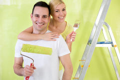Lovers with paint brush painting Stock Images