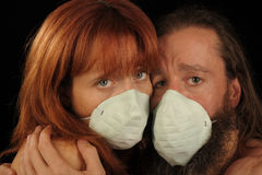 Lovers In a Pandemic. Image of two Lovers Caught in a Flu Pandemic Royalty Free Stock Photo