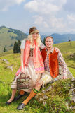 Lovers pants in fashionable traditional Bavarian Dirndl and leather with hat Stock Photography