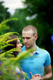 Lovers in the park on a date Stock Images