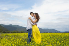 The lovers passionately embrace each other. The lovers passionately embrace each other on the flowery meadow Royalty Free Stock Photo