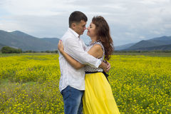The lovers passionately embrace each other. The lovers passionately embrace each other on the flowery meadow Stock Image