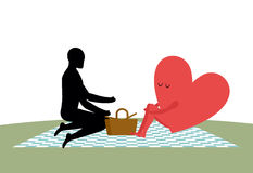 Lovers on picnic. Rendezvous in Park. The heart of man. Rural ja Royalty Free Stock Photography