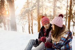 Lovers at a picnic in the winter in the forest Royalty Free Stock Photos