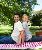 Lovers picnicking outside Stock Image