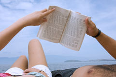 Lovers reading a book  Stock Image