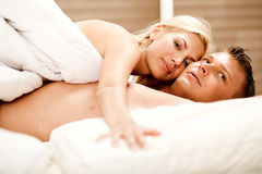 Lovers relaxing in bed Stock Photo