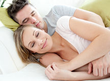Lovers relaxing together on a sofa Stock Photo