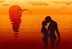 Lovers in the sea at sunset Royalty Free Stock Photo