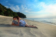 Lovers on a seclude beach. Young romantic couple making out on secluded beach Stock Photography