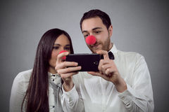 Lovers selfie. Studio portrait of two fun lovers royalty free stock photo