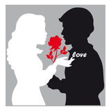 Lovers silhouette. Black and white  silhouettes of two lovers  on gray background with a red rose and text Stock Image
