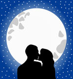 Lovers Silhouette Kissing at Moonlight. Illustration featuring silhouette of two lovers kissing against a big surreal  full moon in a starry romantic sky. Eps Royalty Free Stock Photography