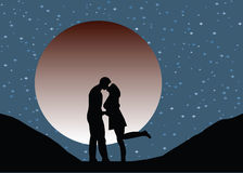 Lovers silhouette kissing at moonlight Royalty Free Stock Image