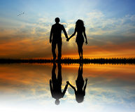 Lovers silhouette at sunset Royalty Free Stock Photo