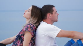 Lovers sitting on the bank of the river stock footage