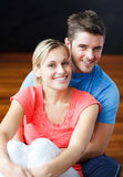 Lovers sitting together on the floor and smiling Royalty Free Stock Images