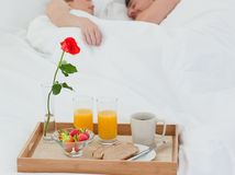 Lovers sleeping after having breakfast Royalty Free Stock Photo