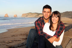 Lovers smiling. Image shows lovers smiling on a beach Stock Photos