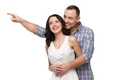Lovers smiling and looking at something with Royalty Free Stock Images