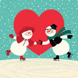Lovers snowmen at the ice rink. Two lovers snowmen having fun skating Stock Photos