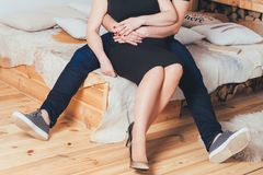 Lovers embrace each other in a modern fashionable apartment. Lovers spend time together in a modern fashionable apartment. They embrace each other and kiss. They Stock Image
