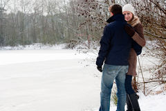 Lovers standing near a frozen lake Royalty Free Stock Images