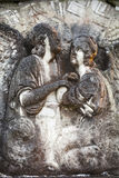 Lovers in Stone in Scotland. Lovers Sculpture on Tomb by Loch Ness in Scotland royalty free stock photography