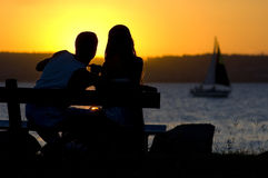 The lovers by the sun Stock Photos