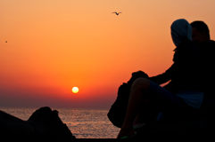 Lovers sunset. Lovers in romantic sea sunset Stock Image