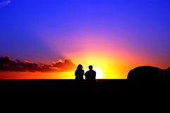 Lovers and sunset. Thinking about the future royalty free stock photo