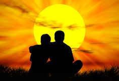 Lovers at sunset Royalty Free Stock Photos