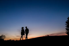 Lovers on sunset background. Royalty Free Stock Image