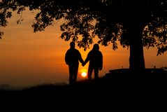 Lovers in the sunset stock photos