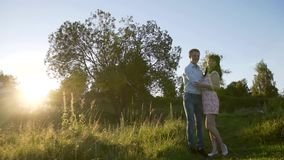 Lovers at sunset sun. HD stock footage