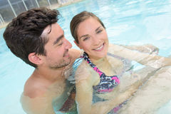 Lovers in swimming pool stock photo