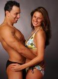 Lovers in swimwear Stock Photography
