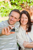 Lovers taking a photo of themselves in the garden Royalty Free Stock Photo