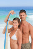 Lovers with their surfboard Royalty Free Stock Photography