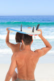 Lovers with their surfboard Stock Photo