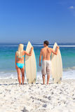 Lovers with their surfboards Royalty Free Stock Photo