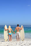 Lovers with their surfboards Royalty Free Stock Photography