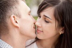 Lovers about to kiss Royalty Free Stock Photography