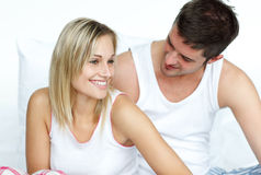 Lovers together sitting on bed Royalty Free Stock Photo