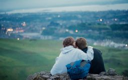 Lovers on top of the mountain. Shoot in Edinburgh, UK, lovers on top of the mountain Royalty Free Stock Photo