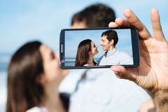 Lovers on travel taking smartphone selfie photo Royalty Free Stock Image